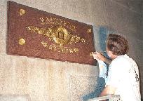 Michael Kramer toning the gilded medallions on the Bremen stone.